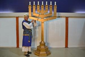 Pastor Bill in Priest garment with Menorah.